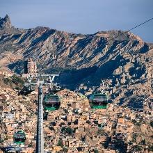 Cable car gondolas travel above a city