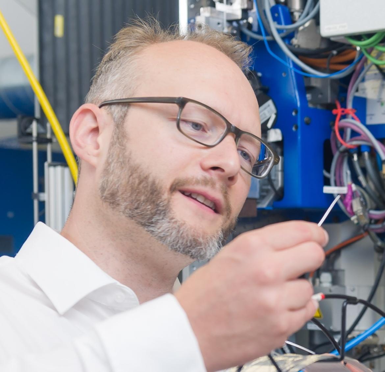 Dr. Max Hoßfeld in Forschungsumgebung