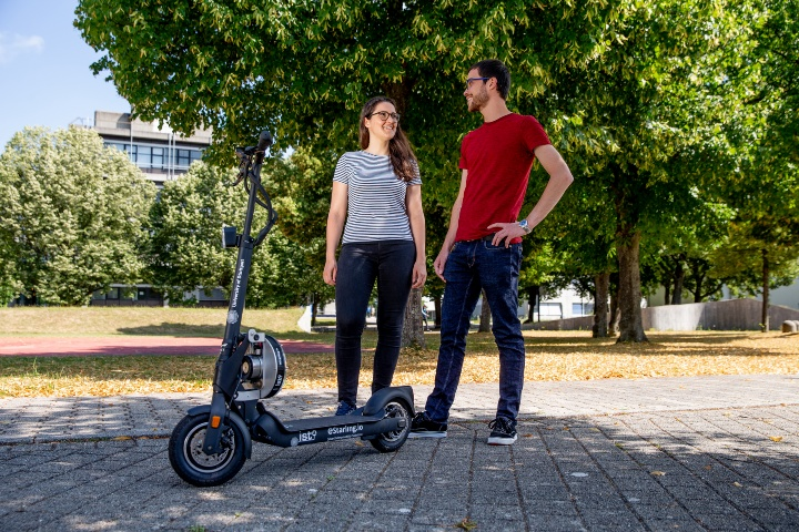 Woman and man with e-scooter