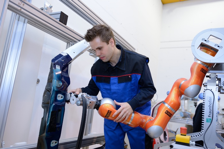 New ways of human-robot team work in place of the rigid assembly line. (c) ARENA2036