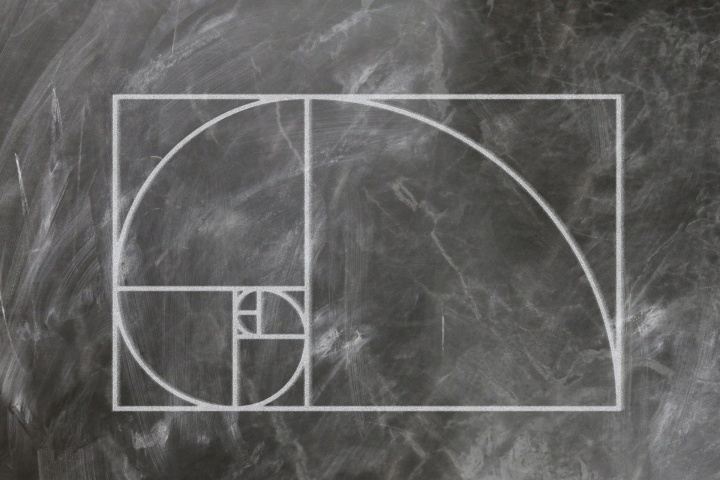 Fibonacci spiral, drawn with chalk on a blackboard