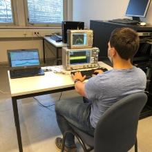 Student plays software back to hardware, for validation of GNSS algorithms developed at INS.