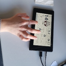 Hand operating the tactile user interface