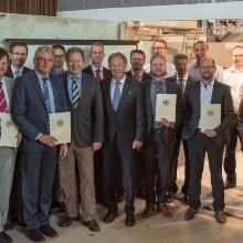 Press release 040: Hand-over of the funding notices at the Institut für Werkstoffe im Bauwesen (IWB) from the University of Stuttgart.  Copyright: University of Stuttgart/Max Kovalenko