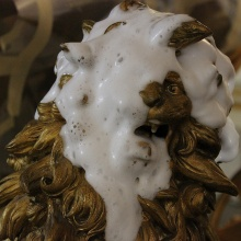 Head of a lion sculpture during cleaning with foam